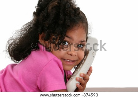Beautiful three-year-old African American girl talking on phone. - stock photo