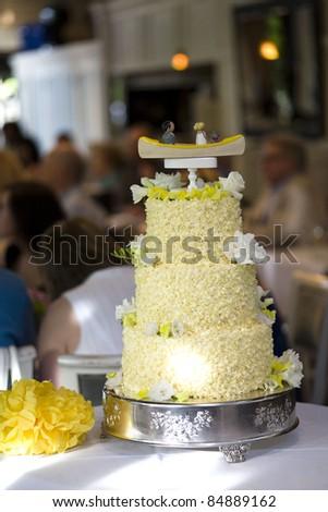 beautiful tiered yellow wedding cake - stock photo