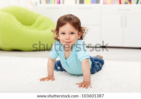 Beautiful toddler child - playing on the floor at home - stock photo