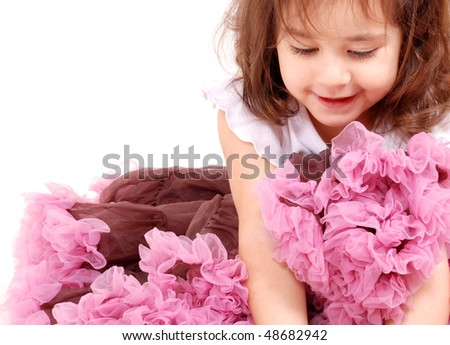 beautiful toddler girl in pretty frilly skirt - stock photo
