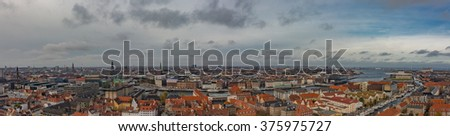 Beautiful top view panoramic of Copenhagen roofs, Denmark from above - stock photo