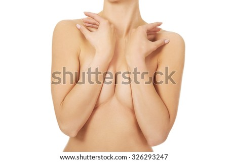 Beautiful topless woman covers her breast - stock photo