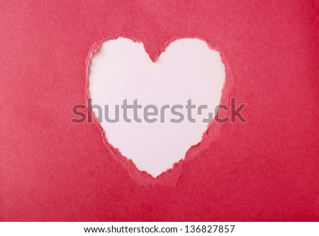 Beautiful torn paper in heart shape symbol - stock photo