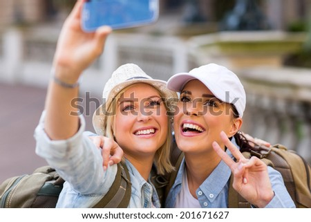 beautiful tourists taking a selfie with smart phone camera - stock photo