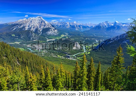 Beautiful town of Banff Nestled in Valley in Banff National Park, Canada - stock photo