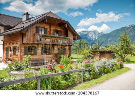 Beautiful traditional Alpine house in the mountains - stock photo