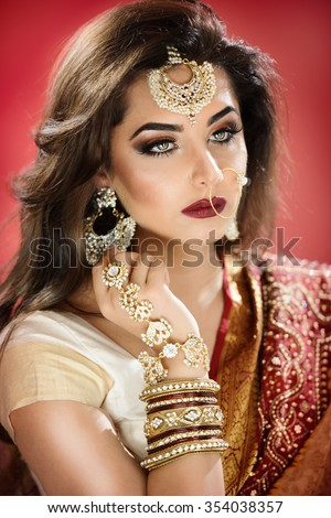 Beautiful traditional bride with heavy jewellery and ethnic jewellery - stock photo