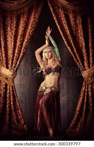 Beautiful traditional female dancer. Ethnic dance. Belly dancing. Tribal dancing. - stock photo