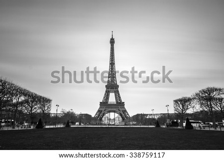 Beautiful tranquil long exposure view of the Eiffel tower in Paris, France, in black and white - stock photo