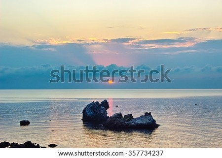 Beautiful tranquil sunrise with dramatic sky on Black sea coast. HDR image made from three photos - stock photo