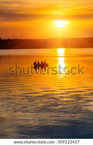 Beautiful tranquil sunset on a lake - stock photo
