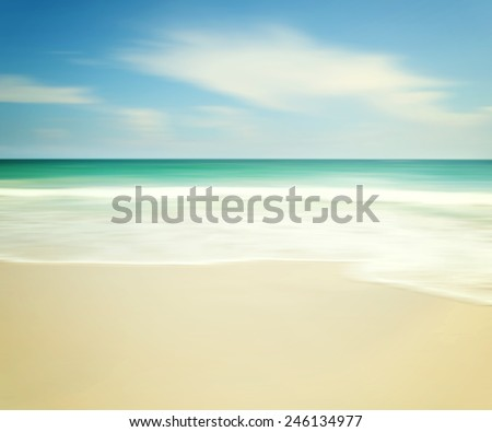 beautiful tropical beach, An abstract ocean seascape with blurred panning motion - stock photo
