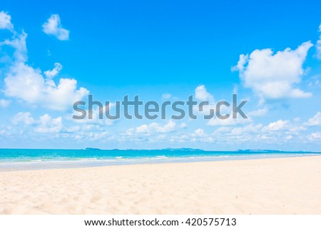 Beautiful tropical beach and sea with white cloud and blue sky background - Boost up color Processing - Holiday Vacation concept for background - stock photo