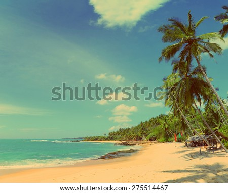 beautiful tropical beach landscape with clouds - vintage retro style - stock photo