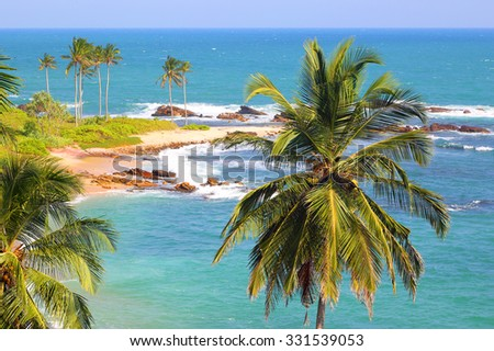 beautiful tropical beach landscape with turquoise sea and clouds - stock photo