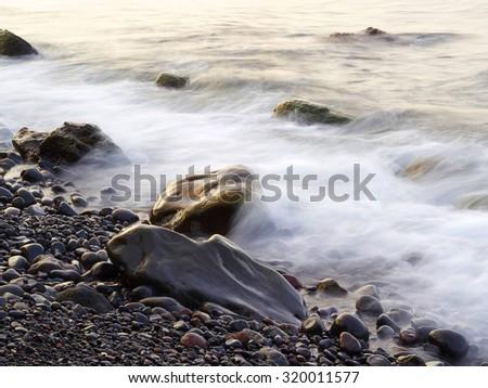 Beautiful tropical beach wave with rock, Bali, Indonesia - stock photo