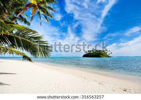 Beautiful tropical beach with palm trees, white sand, turquoise ocean water and blue sky at Cook Islands, South Pacific - stock photo