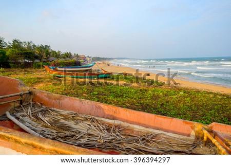 beautiful tropical coast with fishing boats at Indian Ocean. Tamil Nadu, India  - stock photo