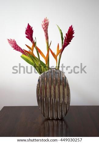 Beautiful tropical flower arrangement - stock photo