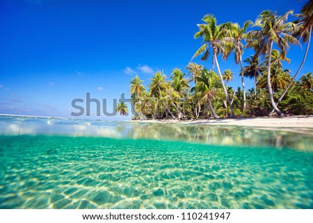 Beautiful tropical island at Tikehau atoll in French Polynesia - stock photo