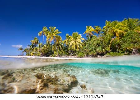 Beautiful tropical island at Tikehau atoll in French Polynesia - stock photo