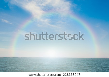 Beautiful tropical ocean with rainbow. - stock photo