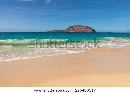 Beautiful tropical paradise beach Baja de los Conchas in Isla Graciosa, Canary Islands, Spain. - stock photo