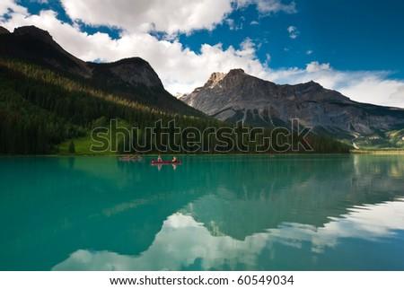 beautiful turquoise emerald lake with canoes in yoho national park canada - stock photo