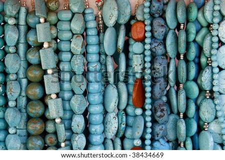 Beautiful turquoise gemstone necklaces on display on the market - stock photo