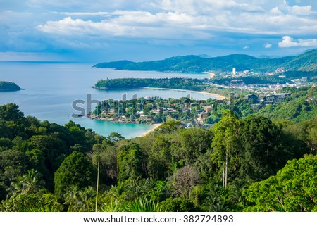 Beautiful turquoise ocean waives with boats and sandy coastline from high view point. Kata and Karon beaches, Phuket, Thailand - stock photo