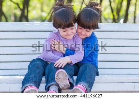 Beautiful twins hugging - stock photo