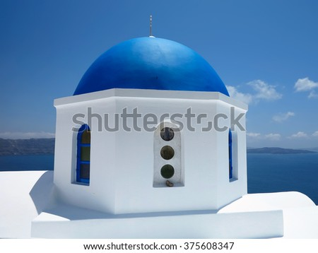 beautiful typical blue dome church over blue sky on Santorini island Greece - stock photo