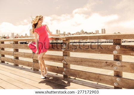 Beautiful urban woman, girl on pier in San Francisco - stock photo