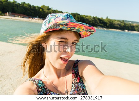 Beautiful urban woman making selfie - stock photo