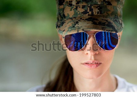 Beautiful US army girl head in combat uniform - stock photo