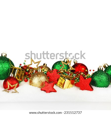 Beautiful various christmas decor on snow close-up - stock photo