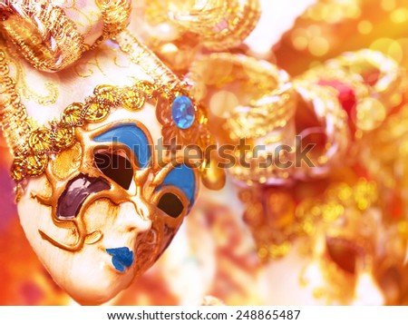 Beautiful Venetian mask decorated with gold, traditional carnival face accessory, fashion lifestyle, art and fantasy concept - stock photo