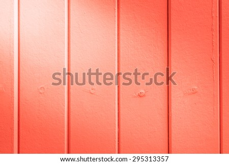 beautiful vertical red wood background texture with light from corner - stock photo