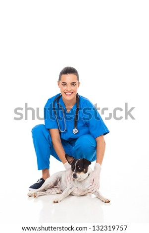 beautiful veterinarian assistant with pet dog isolated on white background - stock photo