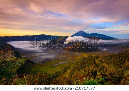 Beautiful Vibrant Bromo volcano at sunrise,Tengger Semeru National Park, East Java, Indonesia - stock photo