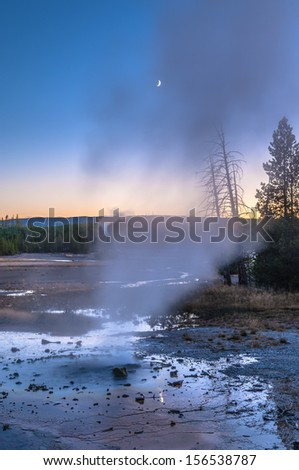 Beautiful Vibrant Geysers in Norris Basin Yellowstone after Sunset - stock photo