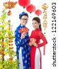 Beautiful Vietnamese in traditional clothes celebrating New Year - stock photo