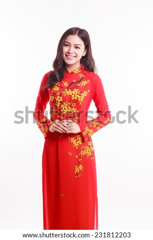 Beautiful Vietnamese woman with red ao dai for celebrate lunar new year on white background - stock photo