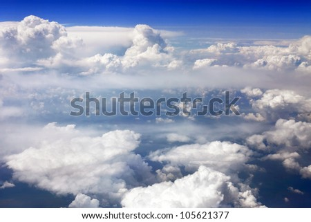 Beautiful view above the earth at the clouds below. - stock photo