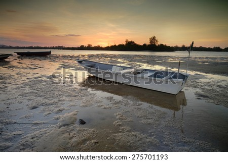 Beautiful View at Gayang Fisherman Village during Sunset with boats. Sabah Borneo. Image has grain or blurry or noise and soft focus when view at full resolution.  (Shallow DOF, slight motion blur)  - stock photo