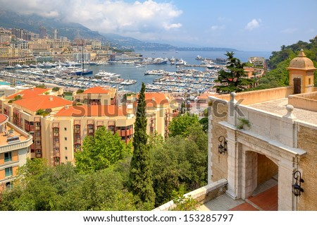 Beautiful view from ancient fortifications on port with yachts of Monte Carlo and residential buildings of Condamine quarter in principality of Monaco. - stock photo