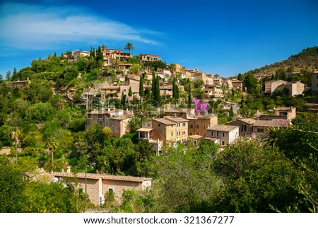 beautiful view of a small mountain village Deia in Mallorca, Spain - stock photo