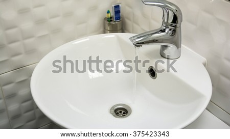 Beautiful view of a white sink, white bathroom - stock photo