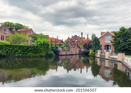Beautiful view of Bruges' canals and architecture of old town - stock photo