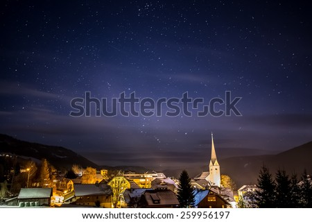 Beautiful view of clean night starry sky over highland Austrian town - stock photo